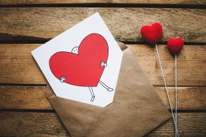 white-black-and-red-person-carrying-heart-illustration-in-867462